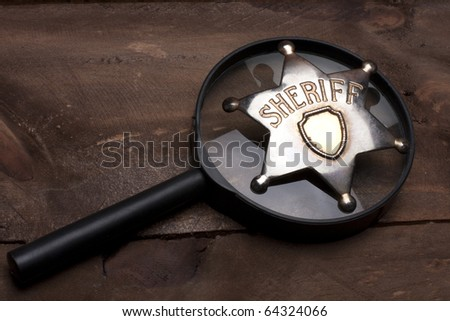 old sheriff badge close up - stock photo