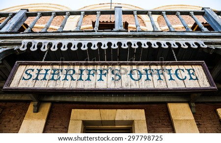 Old Sheriff Office cartel, made of wood, useful for concepts - stock photo