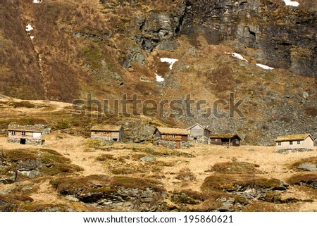 Old shielings in the mountains, where the sheep and cattle were kept in the summer time. - stock photo