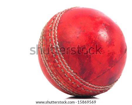 Old shiny red cricket ball that has been well used - stock photo