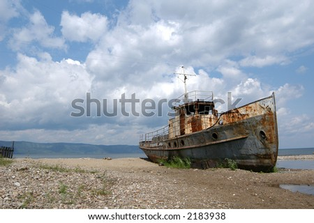 Old ship at the bank of Lake Baikal in Siberia, Russia - stock photo