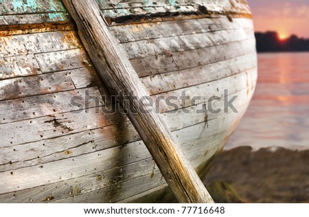 Old ship in low tide at dusk. - stock photo