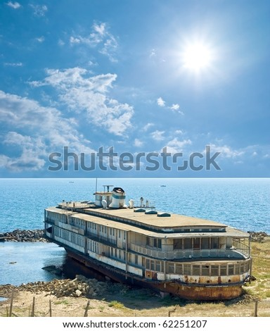 old ship on a sandbank - stock photo