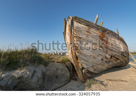old Shipwreck at Low Tide in France, Normandy - stock photo