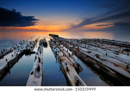Old Shipwreck, Sunset on the shores of lake Superior Pictured Rocks National lakeshore. - stock photo