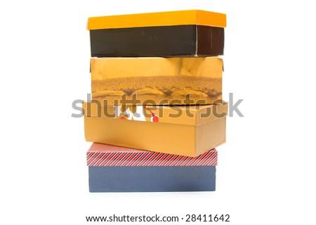 Old shoe boxes isolated on white - stock photo