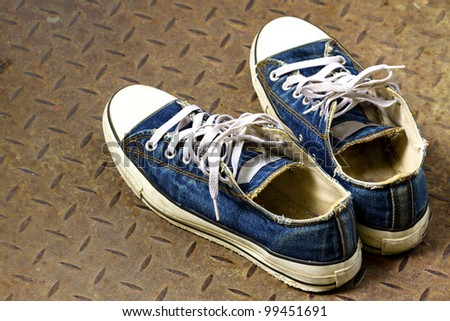 Old shoe on the Iron ground - stock photo