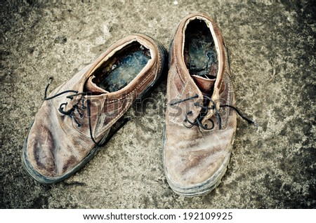 old shoes on the floor - stock photo