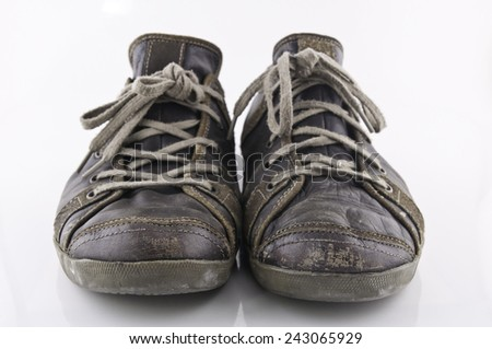 Old shoes on white background - stock photo