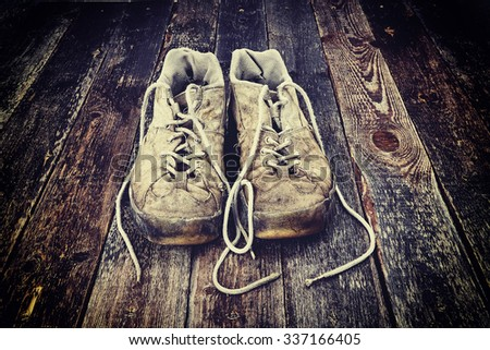 Old  shoes on wooden floor. - stock photo