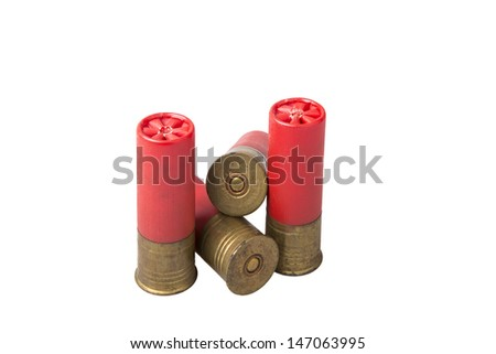 Old shotgun shells against white background with space for copy. - stock photo