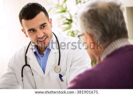 Old sick man visit doctor, patient care  - stock photo
