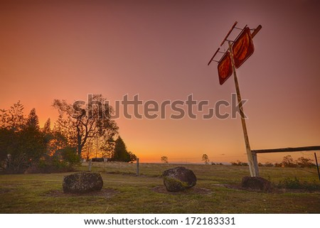 Old sign in the outback - stock photo