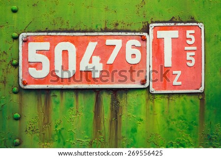 Old sign with engine parameters of a narrow-gauge locomotive. - stock photo