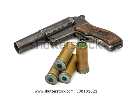 Old  signal pistol, flare gun and cartridges, isolated on white background - stock photo