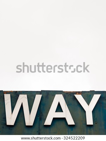 """Old signboard against overcast sky - An old wooden signboard pictured against an overcast sky. The sign says 'WAY"""". - stock photo"""