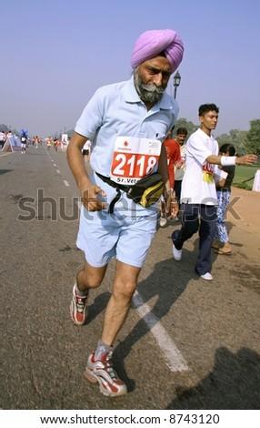 old sikh man at the marathon, delhi, india - stock photo