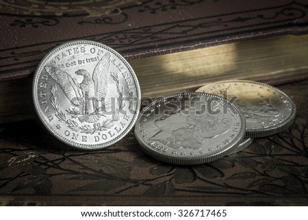 Old silver coins - stock photo