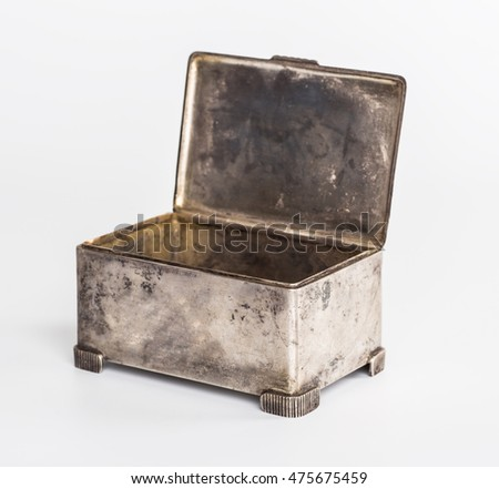 Old silver metallic retro casket over white background
