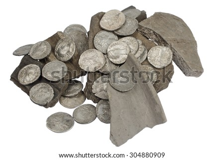 old silver roman coins on the broken pot - stock photo