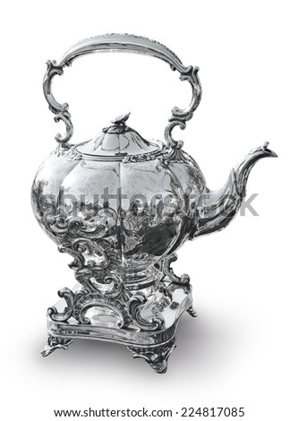Old silver tea or coffee on the stand - stock photo