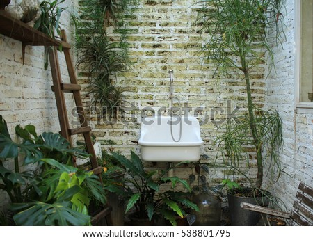 Old sink on brick background