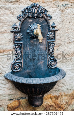 Old sink on the wall - stock photo