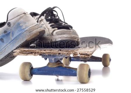 old skateboard & old sneakers, - stock photo