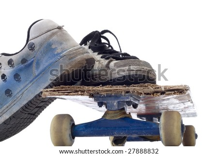 old skateboard & old sneakers - stock photo