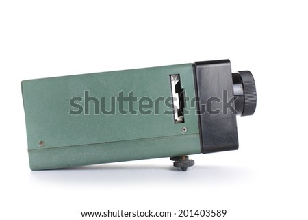 Old slide projector isolated on white background. - stock photo