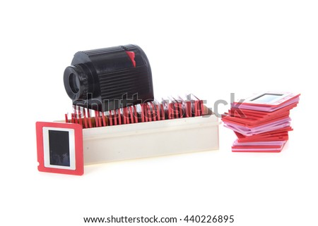 Old slides and projector isolated on a white background - stock photo