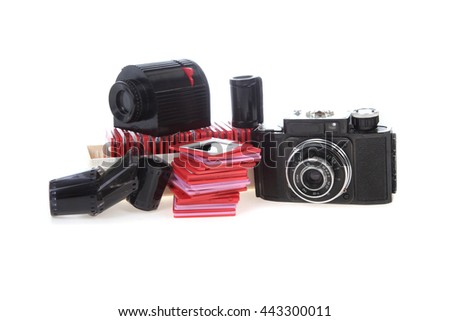 Old slides, camera and projector isolated on white background - stock photo
