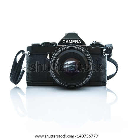 Old SLR Black Camera on White Background - stock photo
