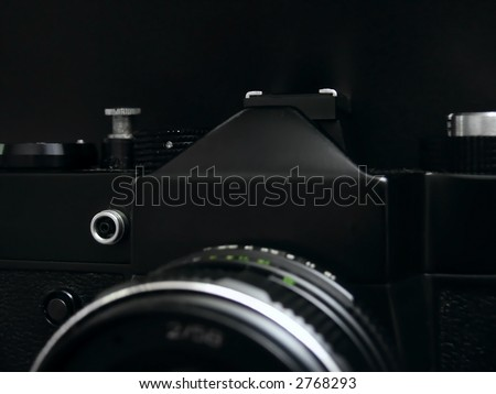 Old SLR camera isolated on black background - stock photo