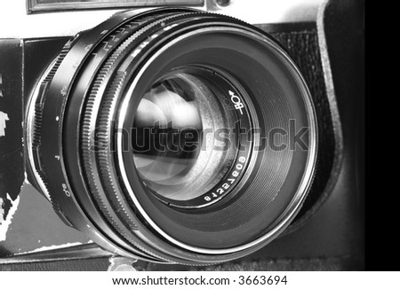 Old SLR camera lens shot isolated on a white background - stock photo