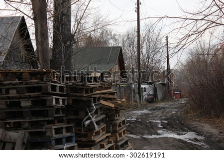 Old slums and Abandoned wooden houses on town outskirt 1334 - stock photo