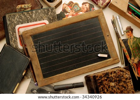 Old small blackboard and other vintage children objects - stock photo