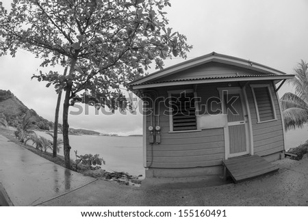 Old small house in front of the Sea in Honduras - stock photo