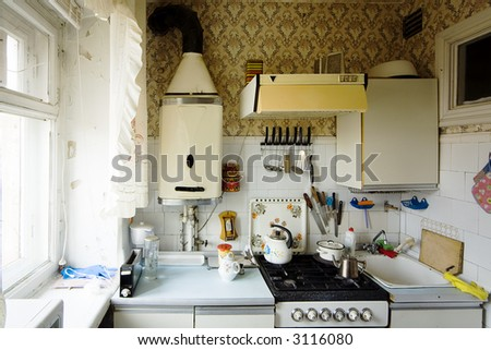 old small kitchen in a multiroom house - stock photo