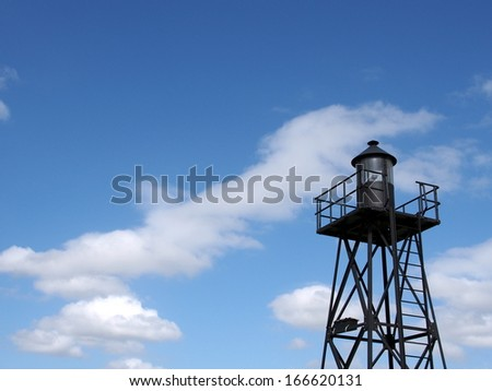 Old small lighthouse and blue sky