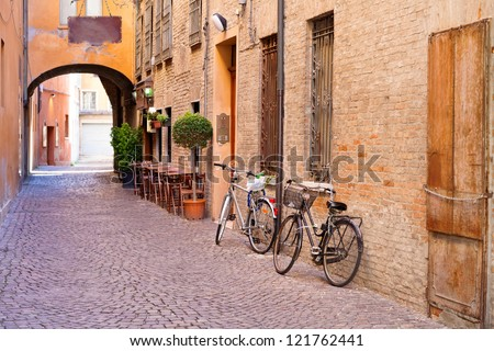 old small stone medieval street in historical center of Ferrara, Italy - stock photo