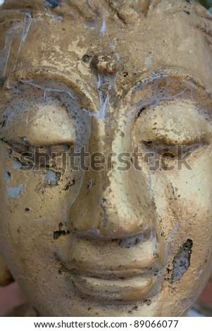 Old smiling budha - stock photo
