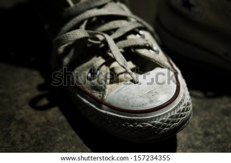 Old sneakers - stock photo