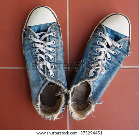 old sneakers in jeans style