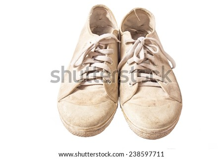 old sneakers on white background. - stock photo