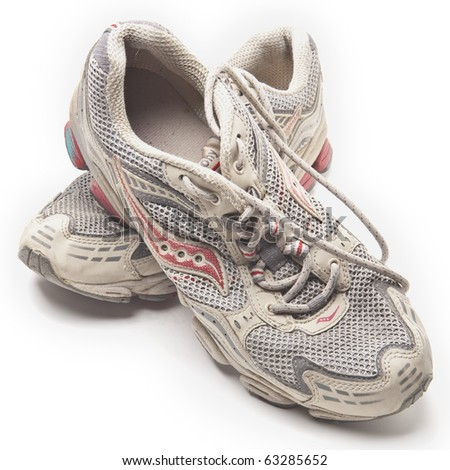 Old sneakers on white background - stock photo