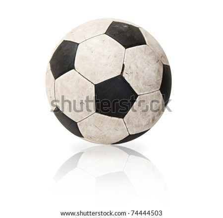 Old soccer ball with reflex - stock photo