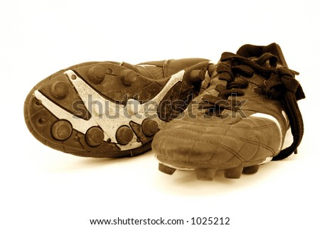 old soccer boot cleats 1 - stock photo