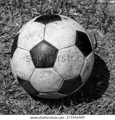Old Soccer grunge ball on grass background. grayscale sad old memory moment  - stock photo