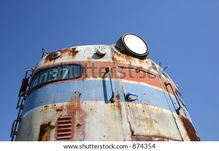 Old soldier of the rails now rests basking in it's former glory. - stock photo